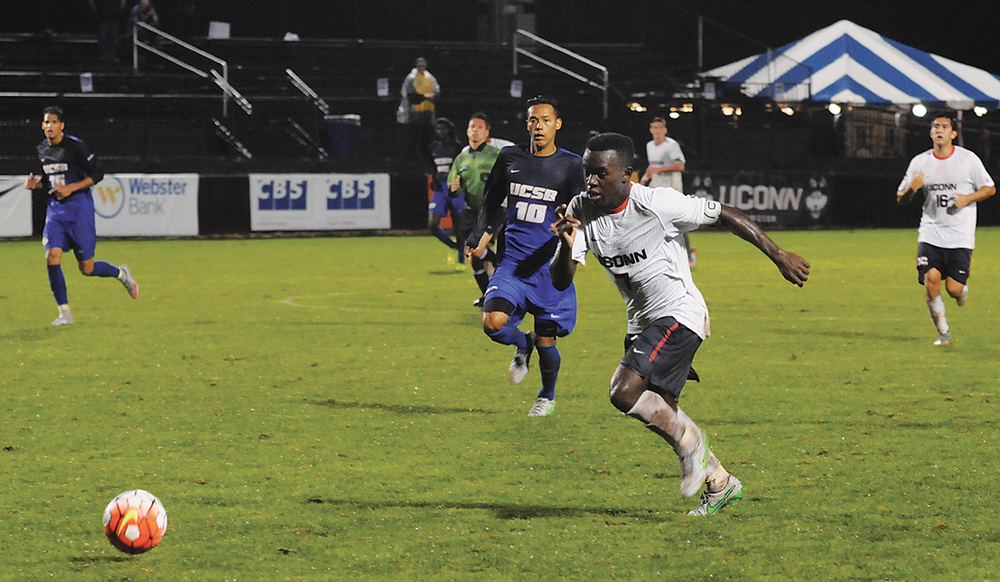 UConn freshman forward Abdou Mbacke Thiam dribbles downfield during the Huskies' game against UC Santa Barbara at Joseph J. Morrone Stadium on Sunday, Sept. 13, 2015. (Amar Batra/The Daily Campus)
