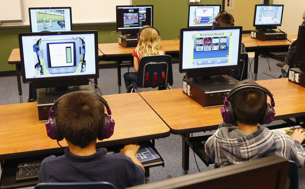 In this July 21, 2014 file photo, students at a summer reading academy at Buchanan elementary school work in the computer lab at the school in Oklahoma City. Wading into one of the most polarizing issues in education, President Barack Obama called Saturday for capping standardized testing at 2 percent of classroom time, while conceding the government shares responsibility for having turned tests into the be-all-and-end-all of American schools. (Sue Ogrocki, File/AP)
