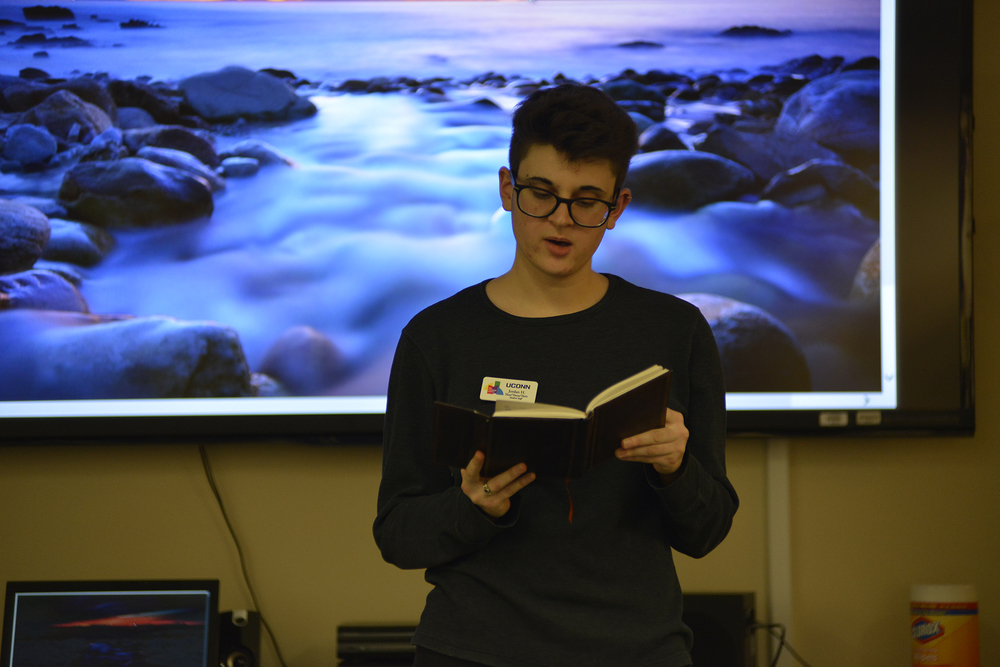 A student reads poetry during a Rainbow Center event in the Student Union on Friday, Oct. 23, 2015. theme was spoken word poetry and it began with a poetry workshop, which transitioned into an open-mic. (Jason Jiang/The Daily Campus)