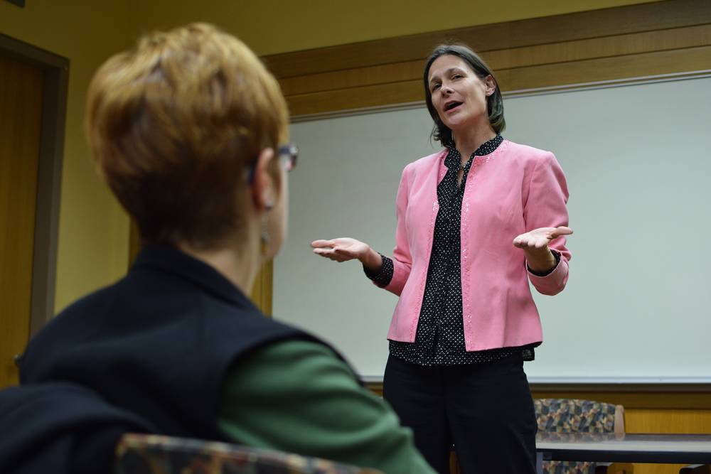 "Barbara Gurr, assistant professor in residence in the Women, Gender and Sexuality Studies department, speaks during ""WGSS, Feminism and the Future: Celebrating New Scholarship"" at Homer Babbidge Library in Storrs, Connecticut on Monday, Oct. 26, 2015. (Grant Zitomer/The Daily Campus)"
