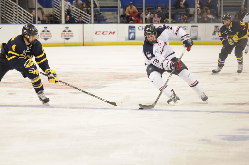 In this file photo, UConn forward Joey Ferriss skates up the ice during the Huskies' game against Merrimack at the XL Center in Hartford, Connecticut on Feb. 10, 2015. (File Photo/The Daily Campus)