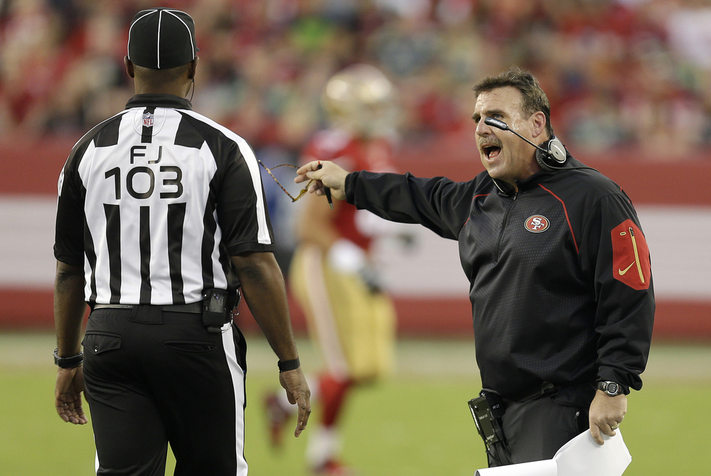 San Francisco 49ers head coach Jim Tomsula, right, talks with field judge Eugene Hall during the first half of an NFL football game against the Seattle Seahawks in Santa Clara, Calif., Thursday, Oct. 22, 2015. (Ben Margot/AP)