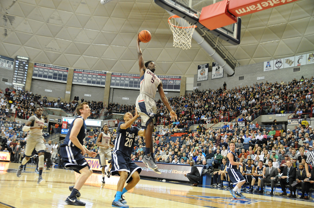 In this file photo, UConn men's basketball forward Daniel Hamilton goes up for a dunk during the Huskies' game against Yale at Gampel Pavilion in Storrs, Connecticut on Dec. 5, 2014. (File Photo/The Daily Campus)