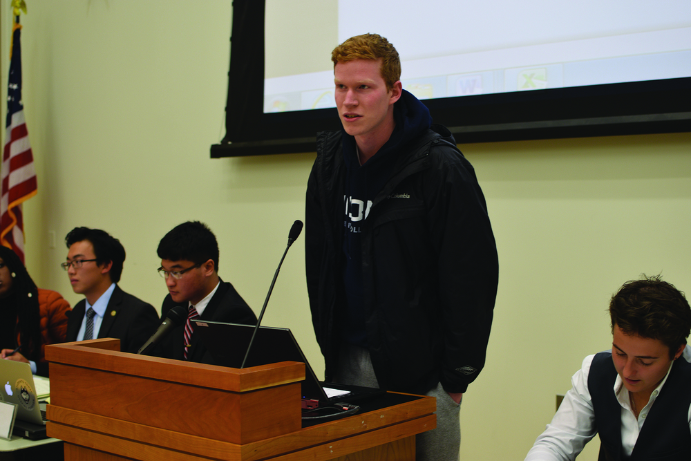 Sean Finan, treasurer of the Men's Club Volleyball team, speaks to USG. One of the hotly debated topics was providing funding for the team after the previous chief financial officer had neglected certain duties to repay the team for past costs. (Grant Zitomer/Daily Campus)