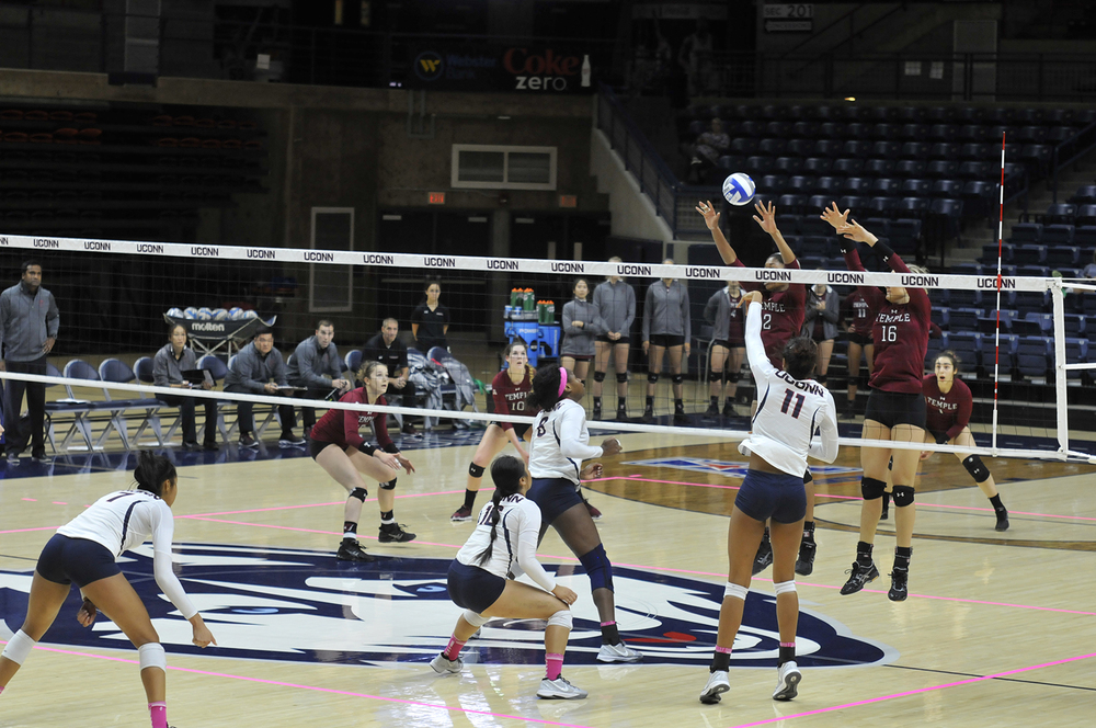 Senior Erika Thomas (11) attempts a block during UConn's 3-2 victory over Temple on October 14th, 2015. The Huskies will travel to Memphis and Cincinnati this weekend. (Amar Batra/The Daily Campus)