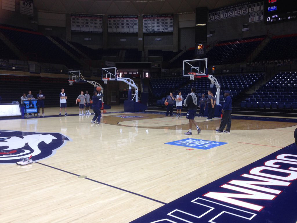 Coach Kevin Ollie participates in a post- practice shooting drill. UConn will take on the University of Tampa on Sunday afternoon for their first exhibition game of the season. (Elan-Paolo DeCarlo/The Daily Campus)