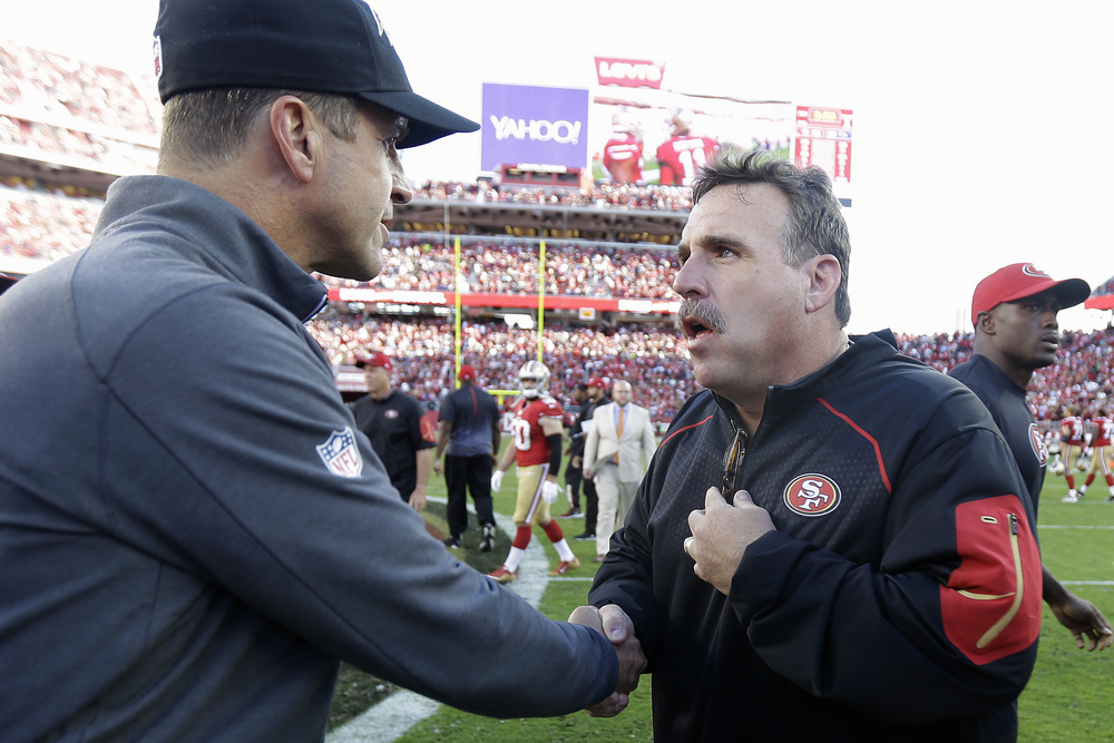 Baltimore Ravens head coach John Harbaugh, left, shakes hands with San Francisco 49ers head coach Jim Tomsula after an NFL football game in Santa Clara, Calif., Sunday, Oct. 18, 2015. The 49ers won 25-20. (Ben Margot/AP)