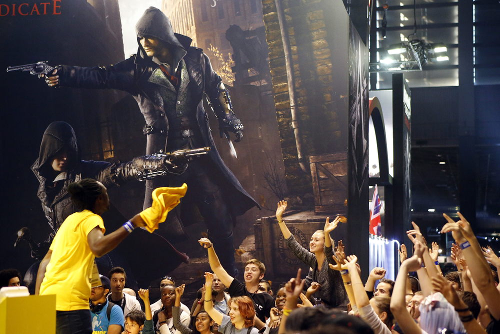 Visitors react at the Paris Games Week, a trade fair for video games in Paris, France, Sunday, Nov. 1, 2015. (AP)