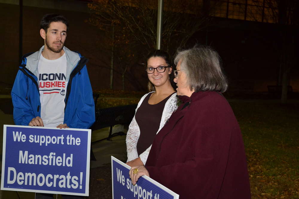 Mansfield Democrat and town council member Antonia Moran (right) stands with two supporters outside the Mansfield Community Center on Election Night in Mansfield, Connecticut on Tuesday, Nov. 3, 2015. (Amar Batra/The Daily Campus)