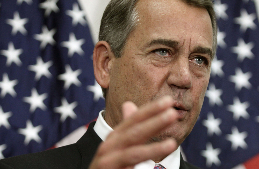 Former House Speaker John Boehner talks with reporters on Capitol Hill on Tuesday after he pushed toward a vote on a two-year budget deal despite conservative opposition, relying on the backing of Democrats for the far-reaching pact struck with President Barack Obama. (AP)