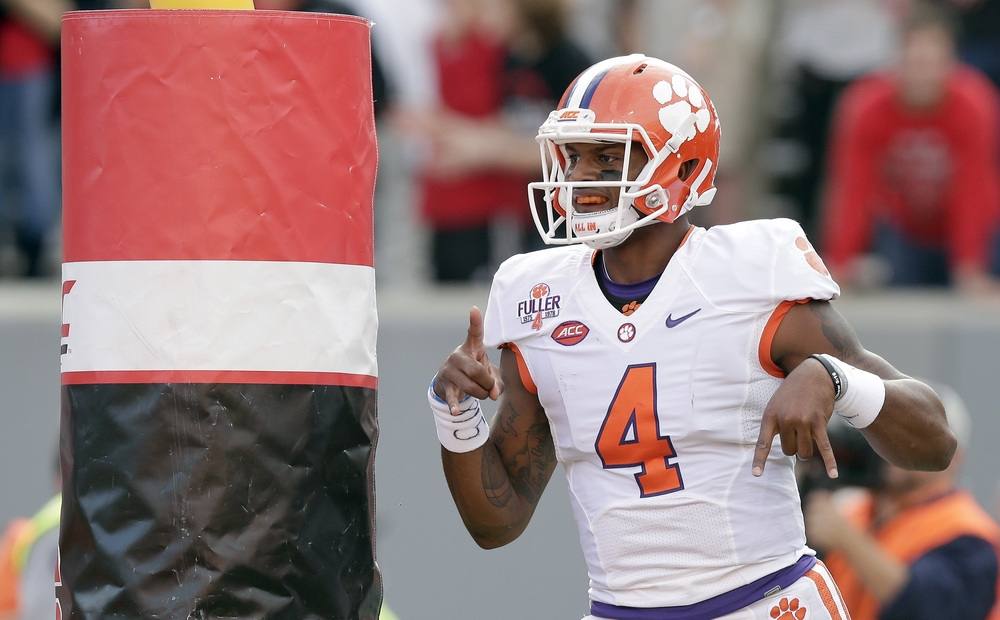 Clemson quarterback Deshaun Watson (4) reacts after his touchdown against North Carolina State during the first half of an NCAA college football game in Raleigh, N.C., Saturday, Oct. 31, 2015. The Tigers were ranked #1 in the first NCAA Playoff Rankings (AP)