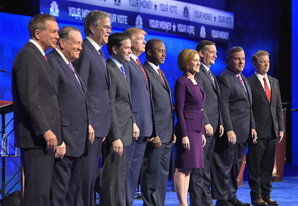 In this photo taken Oct. 28, 2015, Republican presidential candidates, from left, John Kasich, Mike Huckabee, Jeb Bush, Marco Rubio, Donald Trump, Ben Carson, Carly Fiorina, Ted Cruz, Chris Christie, and Rand Paul take the stage during the CNBC Republican presidential debate at the University of Colorado, in Boulder, Colo. (Mark J. Terrill/AP)