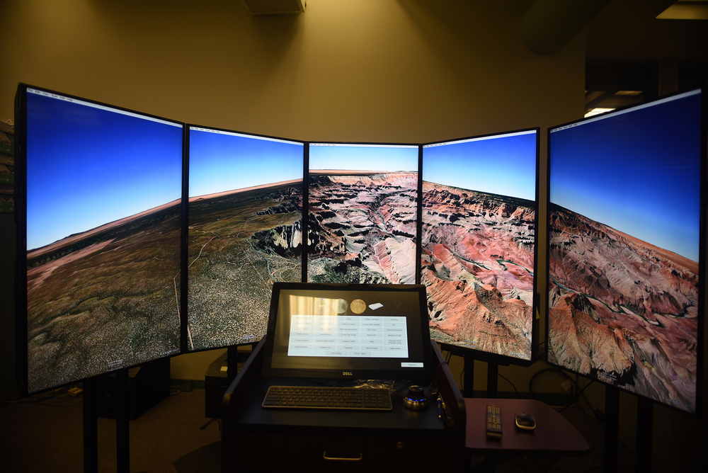 In this photo, the Liquid Galaxy – a data visualization tool for working with Google Earth images of the Earth, Moon and Mars – is seen in UConn's Homer D. Babbidge Library on Tuesday, Nov. 3, 2015. (Allen Lang/The Daily Campus)