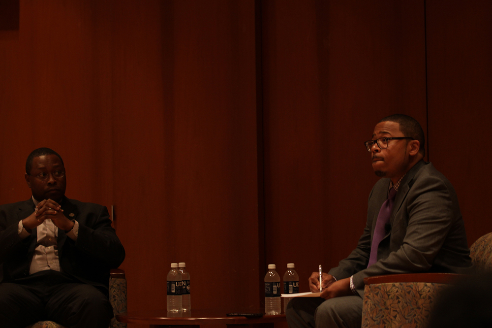 "UConn assistant professor Dr. Erik Hines (right) and Ohio State University distinguished professor Dr. James L. Moore III sit in the Konover Auditorium during the forum ""Black Males in Higher Education: A Conversation with Dr. James L. Moore III"" on Thursday, Nov. 5, 2015. (Mei Buzzell/The Daily Campus)"