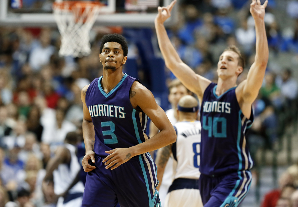 Charlotte Hornets' Jeremy Lamb (3) runs up the court as Cody Zeller (40) celebrates a 3-point basket by Lamb during the second half of an NBA basketball game against the Dallas Mavericks on Thursday, Nov. 5, 2015, in Dallas. The Hornets won 108-94. (AP Photo/Tony Gutierrez)