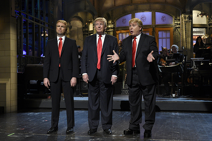 "Taran Killam, left, Republican presidential candidate and guest host Donald Trump, center, and Darrell Hammond perform during the monologue on ""Saturday Night Live"", Saturday, Nov. 7, 2015. Trump's 90 minutes in the ""SNL"" spotlight followed weeks of growing anticipation, increasingly sharp criticism and mounting calls for him to be dropped from the show. (AP)."