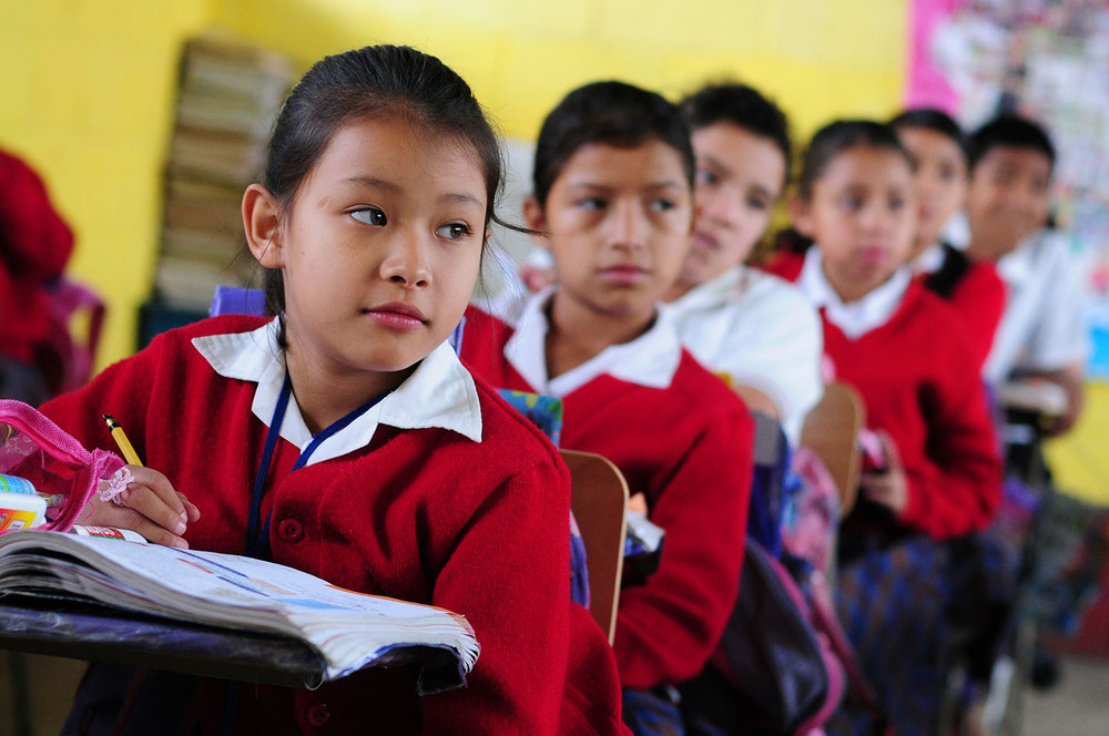 Children in a classroom in El Renacimiento school in Villa Nueva, Guatemala. (Flickr/World Bank Photo Collection)