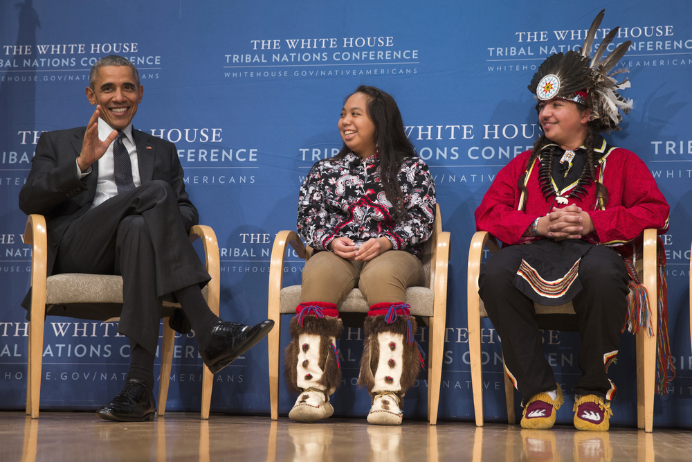 Brayden White of the St. Regis Mohawk Tribe, right, and Tatiana Ticknor of the Yup'ik/Tlingit/Dena'ina, listen as President Barack Obama speaks during the 2015 White House Tribal Nations Conference, Thursday, Nov. 5, 2015, in Washington. (Evan Vucci/AP)