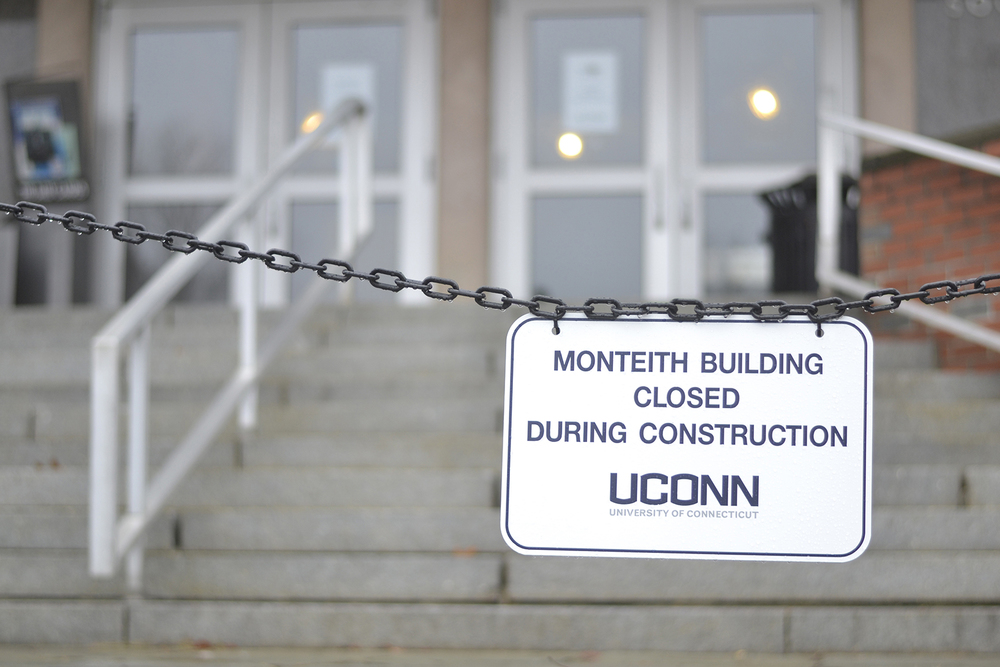In this photo, a sign is pictured in front of the Henry Ruthven Monteith Building in Storrs, Connecticut on Thursday, Nov. 12, 2015. The building renovation is in full swing, with an expected completion date of August 2016. (Rebecca Newman/The Daily Campus)