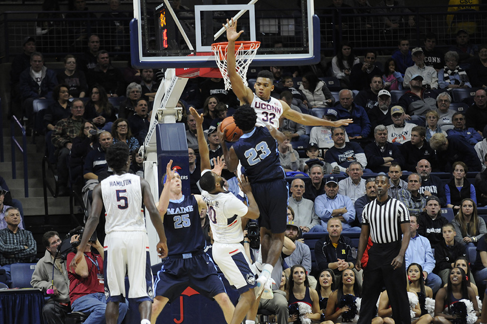 Shonn Miller (#32) rises for a block during UConn's 100-56 victory over Maine at Gampel Pavilion on Friday Nov. 13, 2015. Miller, a graduate transfer making his UConn debut, finished with 17 points and 10 rebounds. (Bailey Wright/The Daily Campus.)