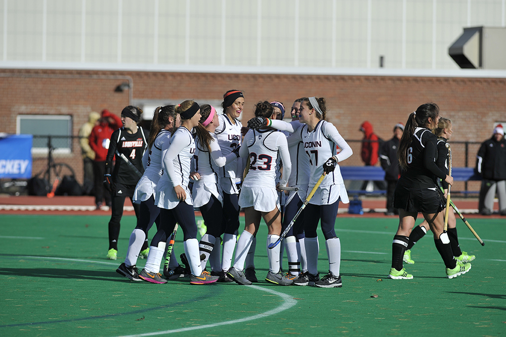 Members of the UConn field hockey team celebrate after a goal during the team's NCAA Tournament first-round game against Louisville at the Sherman Family Sports Complex in Storrs, Connecticut on Saturday, Nov. 14, 2015. (Jason Jiang/The Daily Campus)
