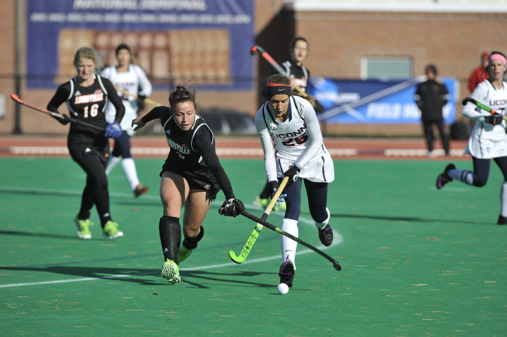 UConn field hockey forward Charlotte Veitner handles the ball during the Huskies' opening round game of the NCAA Tournament against Louisville on Saturday, Nov. 14, 2015. Veitner scored one of the team's three goals. (Jason Jiang/The Daily Campus)