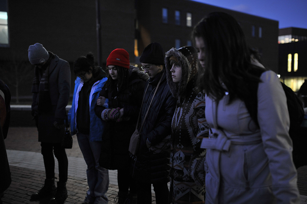 Students are seen at a prayer vigil sponsored by Cru at UConn, an interdenominational Christian organization, on Fairfield Way in Storrs, Connecticut on Saturday, Nov. 14, 2015. Around 20 students attended the vigil. (Jason Jiang/The Daily Campus)