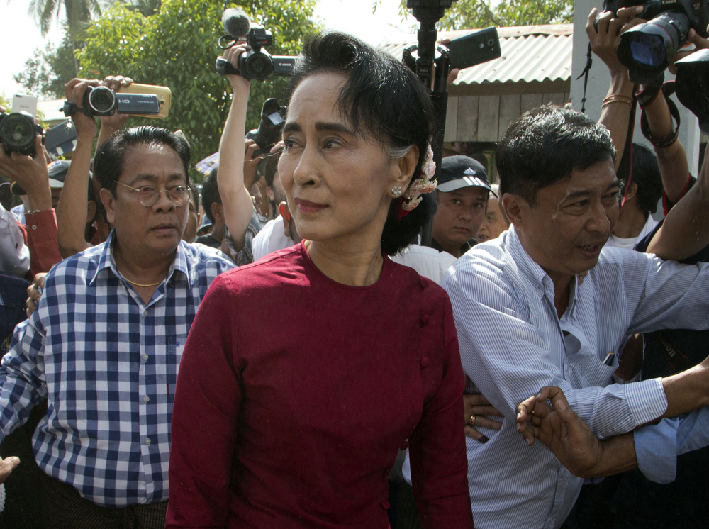 In this Sunday, Nov. 8, 2015, file photo, leader of Myanmar's National League for Democracy party, Aung San Suu Kyi visits a polling station on the outskirts Yangon, Myanmar. Winning Myanmar's election turned out to be easier than expected for Aung San Suu Kyi and her opposition party, but steering the country will be a test of how the Nobel Peace laureate balances her moral vision with political realities. (Mark Baker, File/AP)