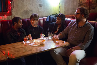 "In this image released by Netflix, from left, Aziz Ansari, Noel Wells, Lena Waithe and Eric Wareheim appear in a scene from the Netflix original series ""Master of None."" The comedy series premieres on Friday. (K.C. Bailey/Netflix via AP)"