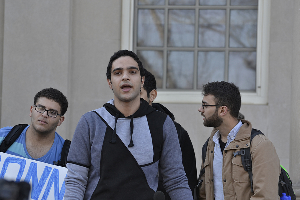 UConn student Mahmoud Hashem (center) speaks on the back steps of the Wilbur Cross building during a demonstration against discrimination and intolerance on Monday, Nov. 16, 2015. (Rebecca Newman/The Daily Campus)