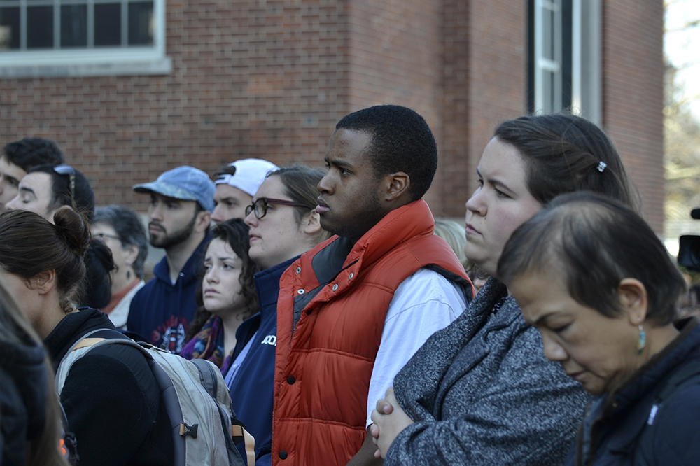 UConn students and staff look on during a demonstration against discrimination and intolerance on the back steps of the Wilbur Cross building on Monday, Nov. 16, 2015. (Rebecca Newman/The Daily Campus)