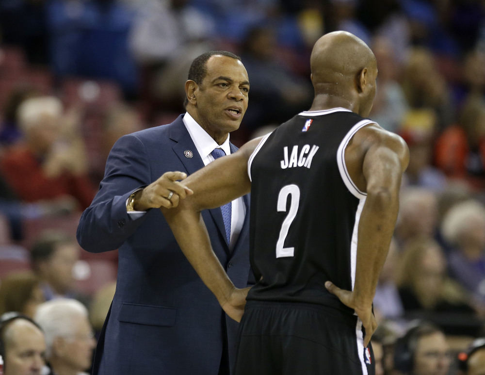 Brooklyn Nets head coach Lionel Hollins talks with guard Jarrett Jack during the first half of an NBA basketball game against the Sacramento Kings in Sacramento, Calif., Friday, Nov. 13, 2015. (Rich Pedroncelli/AP)