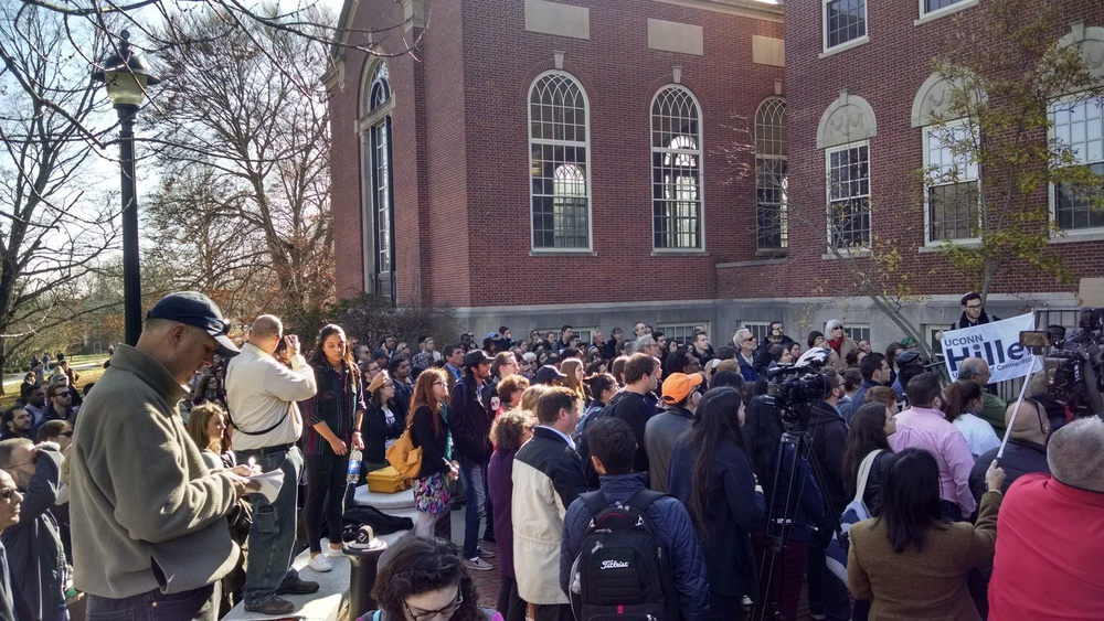 Students, faculty and administrators gathered outside of the Wilbur Cross building on Monday, Nov. 16, 2015 in a demonstration of solidarity against acts of hate on campus. Students addressed a crowd of several hundred gathered during the event. (Kyle Constable/The Daily Campus).