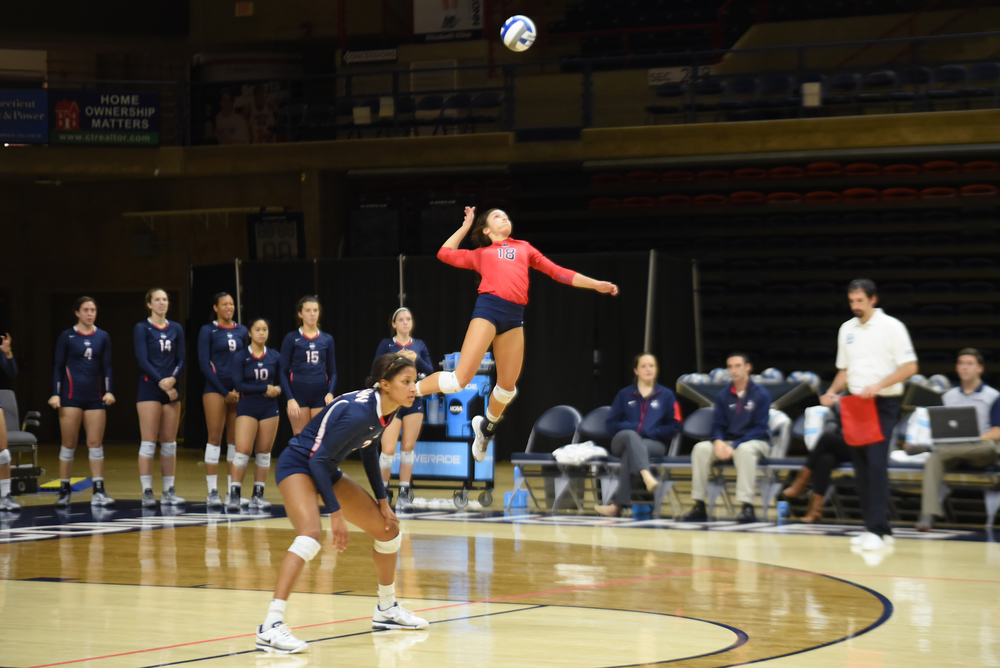 UConn defensive specialist Kennedy Arundel goes up for a serve during the a game at Gampel Pavilion in Storrs, Connecticut. The team will square off against Temple (20-8, 11-5 American) on Wednesday in what is a battle for second place in the conference. (Allen Lang/The Daily Campus)