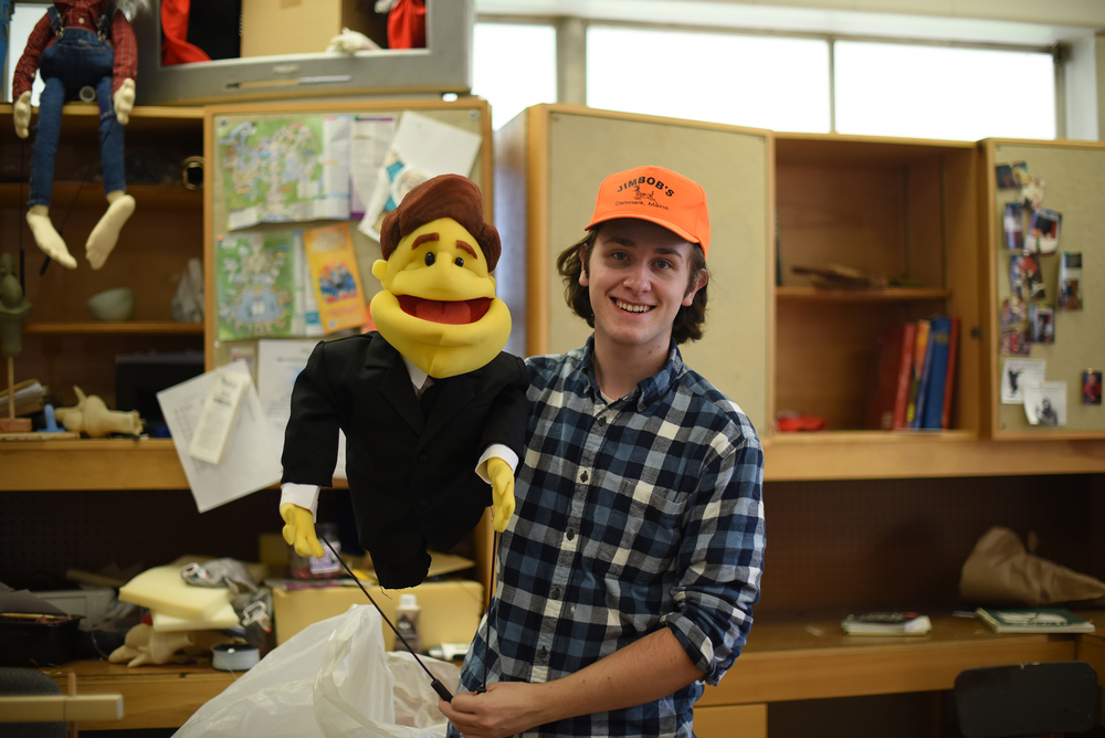 "In this photo, fifth-semester puppet arts major John Cody is pictured. ""Puppetry tricks you into seeing something you're not,"" Cody said. ""You're not actually seeing a living, breathing thing... It's all one big trick, but it's fun, and it takes a lot of effort."" (Allen Lang/The Daily Campus)"