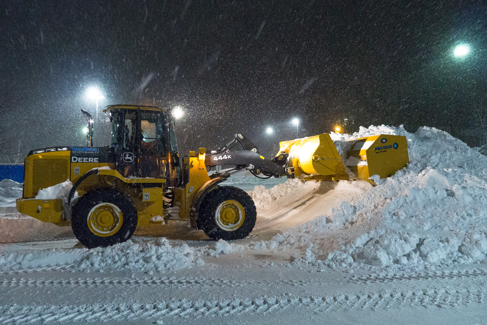In this file photo, a snow plow is seen making snow piles to clear the South parking lot in Storrs, Connecticut on January 27, 2015. Over one hundred new plow trucks and other winter equipment were added to Connecticut's winter maintenance fleet in preparation for the upcoming season. (File Photo/The Daily Campus)
