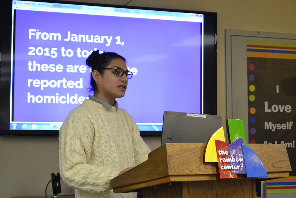 Event coordinator Flavio Espinoza gives a PowerPoint presentation in the Rainbow Center in the UConn Student Union on Tuesday, Nov. 17, 2015, during an event to commemorate members of the transgender community who have been murdered for their identities in the past year. They honored the lives of those who passed away as well as celebrated the achievements of transgender people. (Olivia Stenger/Daily Campus)