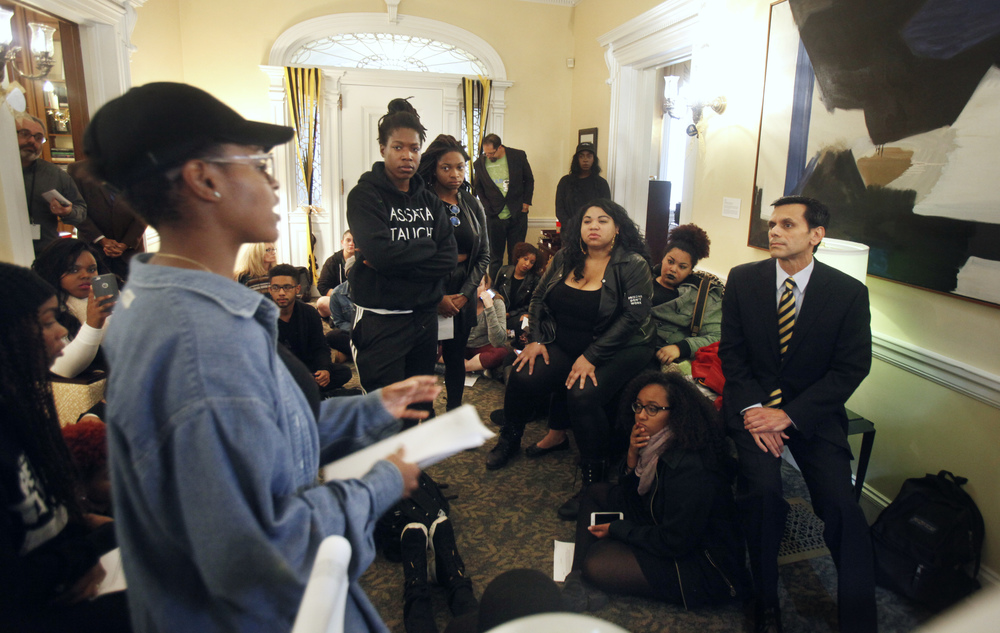 Virginia Commonwealth University President Michael Rao, right, listens to complaints from a group of students inside the entrance of the president's office, Thursday Nov. 12, 2015, in Richmond, Va. Thousands of students across the U.S. took part in demonstrations at university campuses Thursday to show solidarity with protesters at the University of Missouri, and to shine a light on what they say are racial problems at their own schools. (AP)