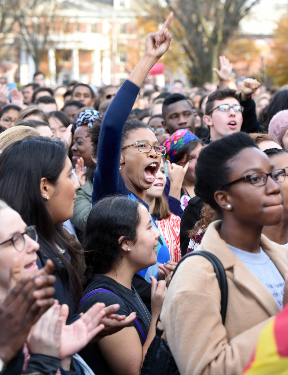 In this Nov. 9, 2015, file photo, Yale University students and faculty rally to demand that Yale University become more inclusive to all students on Cross Campus in New Haven, Conn. At schools including Michigan andYale, students say the protests that led to the resignation of Missouri President Tim Wolfe are emboldening them to take a harder line. (AP)