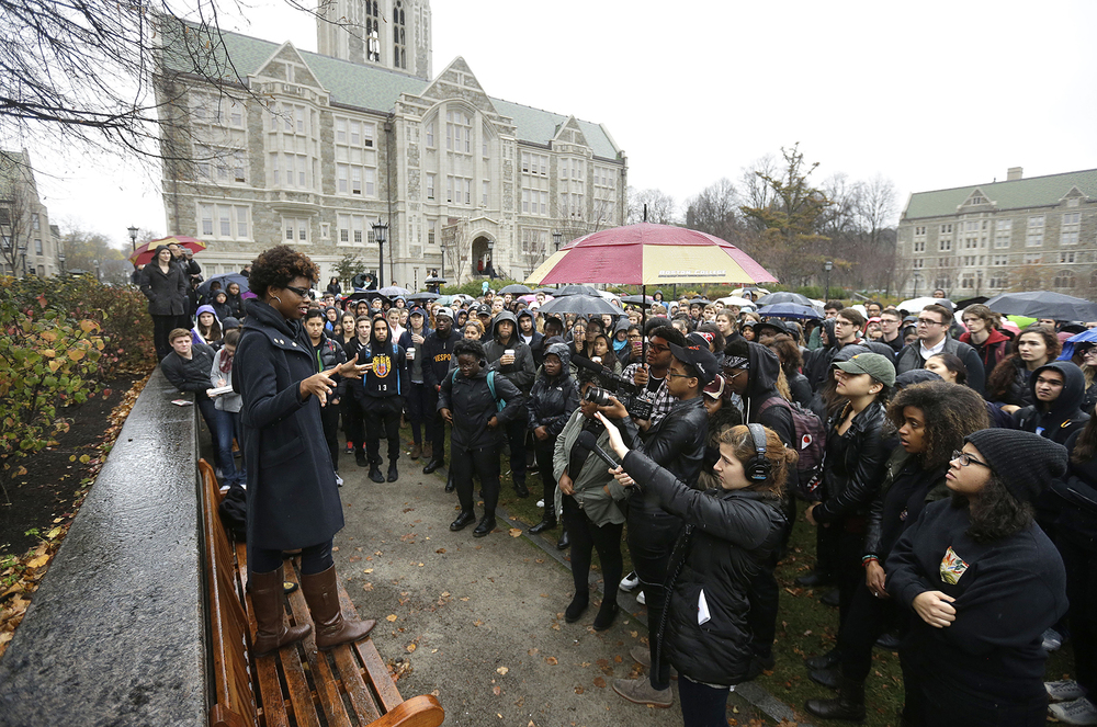 Students at Boston College   listen to a speaker as they gather during a solidarity demonstration on the school's campus, Thursday, Nov. 12, 2015, in Newton, Mass. The protest was among numerous campus actions around the country following the racially charged strife at the University of Missouri. The speaker at left asked not to be identified. (AP)