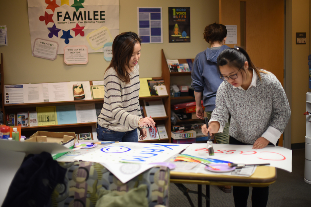 Students design posters for the Rainbow Center's event, Express to De-Stress. (Zhelun Lang/The Daily Campus).