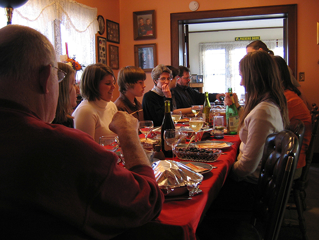 A family  gathered at an undisclosed location for Thanksgiving Dinner in 2009. (Flickr).