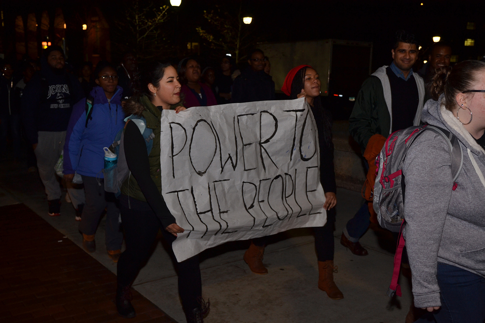 "Students walk during the ""March for Justice, Empowerment and Solidarity,"" holding a sign that reads ""Power To The People"" on Fairfield Way in Storrs, Connecticut on Thursday, Nov. 19, 2015. (Amar Batra/The Daily Campus)"