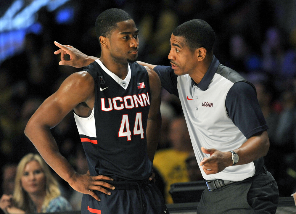 Connecticut coach Kevin Ollie has a word with guard Rodney Purvis (44) during an NCAA college basketball game against Michigan on Wednesday, Nov. 25, 2015, in Paradise Island, Bahamas. (Brad Horrigan/The Courant via AP)