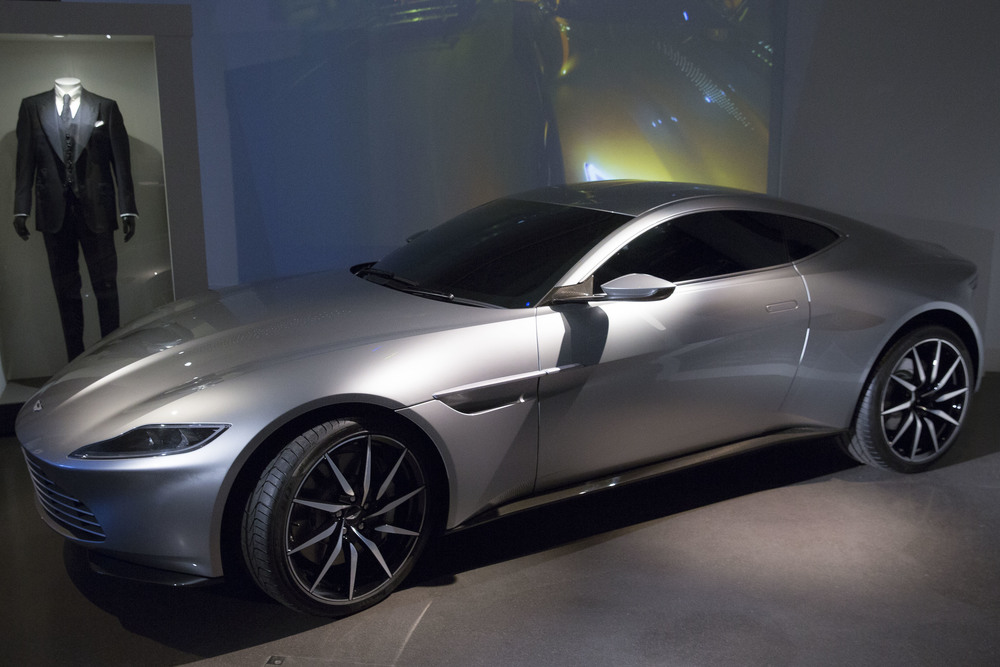 The Aston Martin DB10 and black suit used in the filming of new Bond film Spectre join the largest collection of 007 vehicles in the world, at the London Film Museum, London, Tuesday, Nov. 17, 2015. (Joel Ryan/Invision/AP)