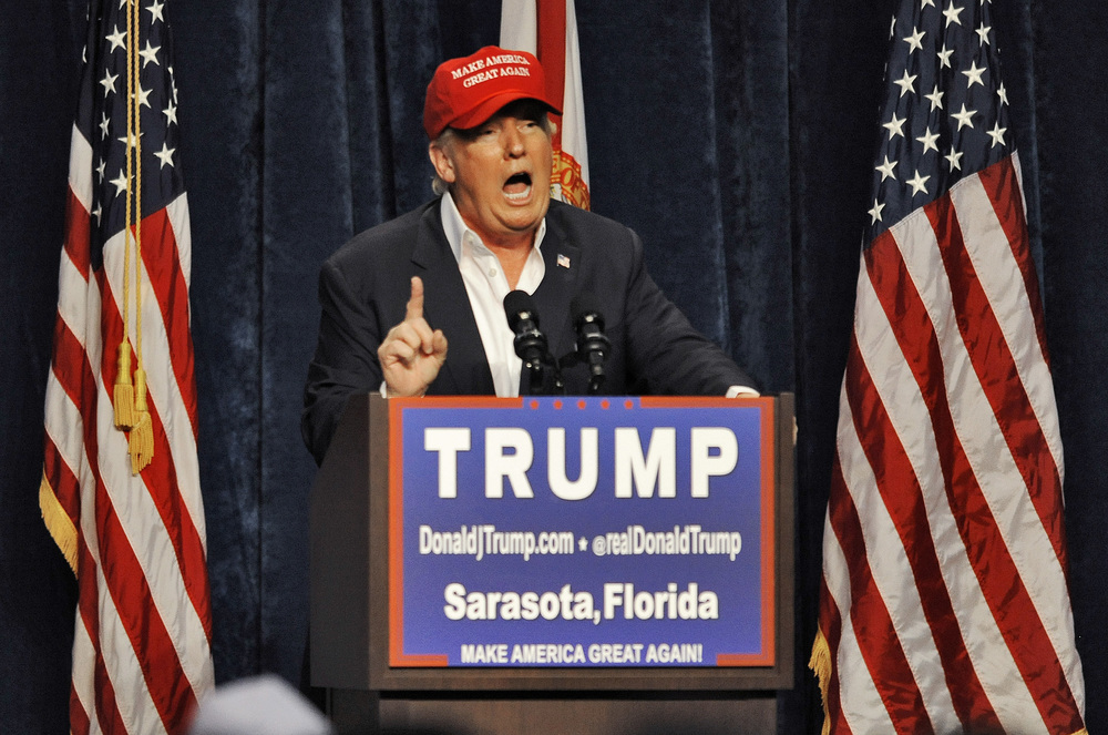 "Republican presidential candidate Donald Trump speaks to supporters at a campaign rally Saturday, Nov. 28, 2015 at Robarts Arena in Sarasota, Fla. Trump bragged about his high standing in the polls, slammed super PACS as ""a scam"" and dismissed nomination rivals Marco Rubio and Jeb Bush in a campaign stop Saturday in their home state of Florida. (Steve Nesius/AP)"