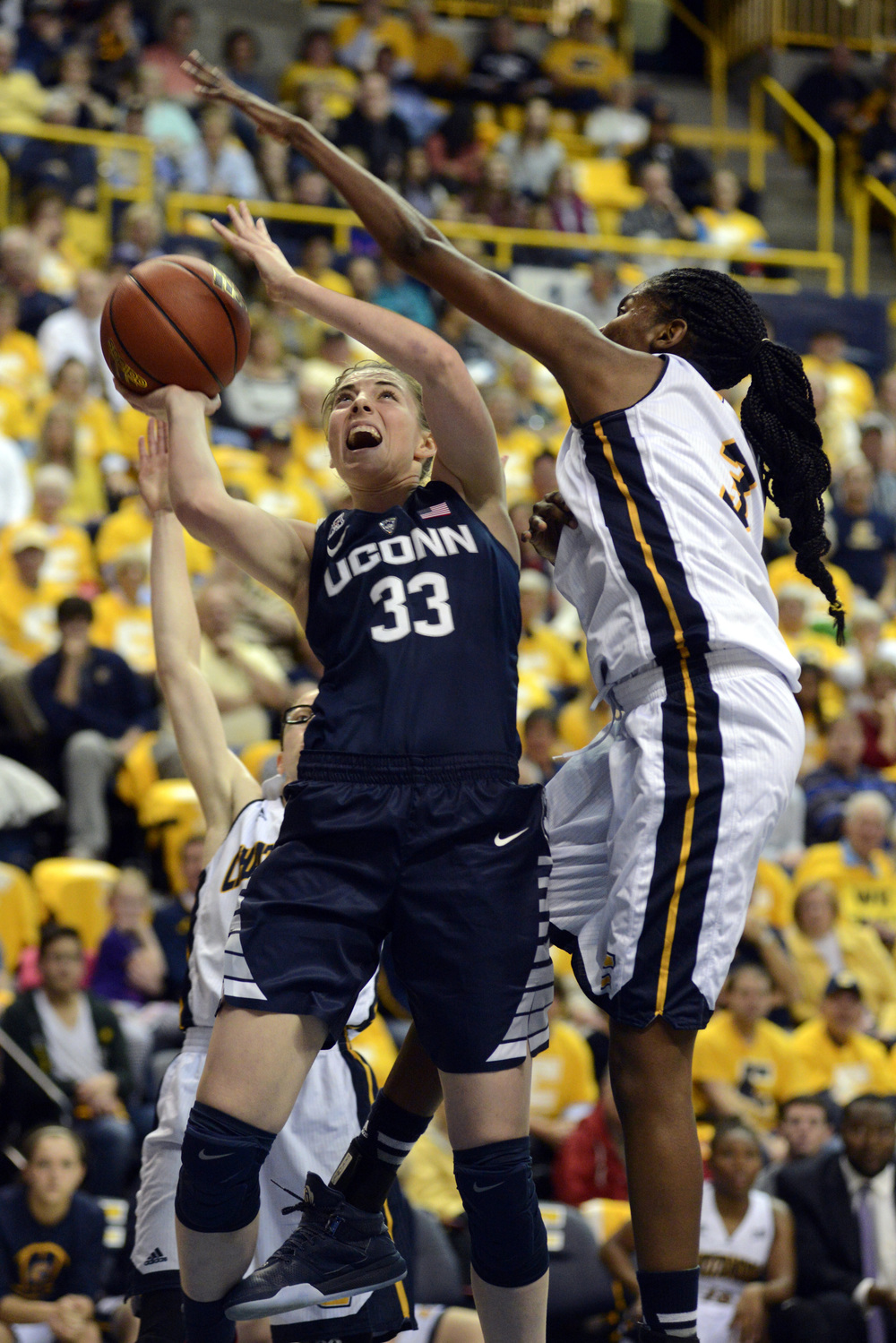 Connecticut guard Katie Lou Samuelson (33) shoots as Chattanooga's Jasmine Joyner (3) defends in the first half of an NCAA college basketball game Monday, Nov. 30, 2015, in Chattanooga, Tenn. (Billy Weeks/AP)