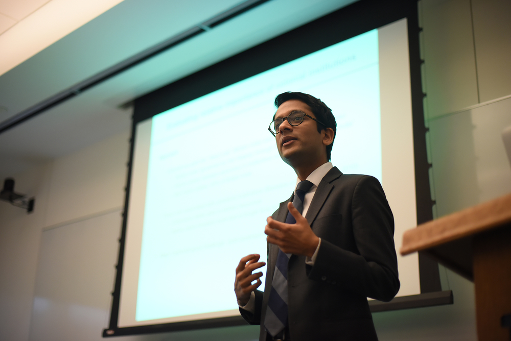 Yale University researcher Nikhar Gaikwad speaks during his lecture in Oak Hall on Monday, Nov. 30, 2015. (Allen Lang/The Daily Campus)