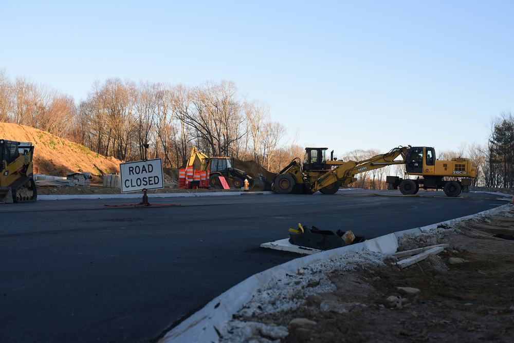 Construction vehicles are seen at the site of the North Hillside Road extension in Storrs, Connecticut on Nov. 29, 2015. The project, which will connect North Hillside Road with Route 44, is scheduled to be completed on Dec. 18. (Allen Lang/The Daily Campus)