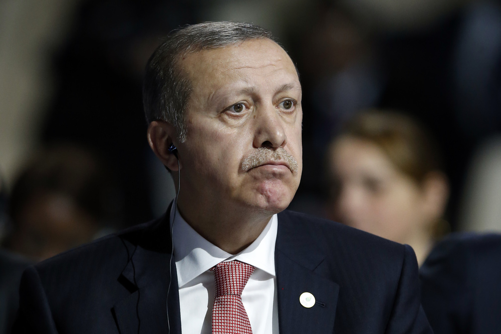 Turkey's President Recep Tayyip Erdogan listens to statements at the COP21, United Nations Climate Change Conference, in Le Bourget, outside Paris, Monday, Nov. 30, 2015. (Francois Mori/AP)